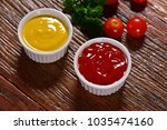 bowls of mustard sauce and... | Shutterstock . vector #1035474160