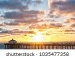 sunset on manhattan beach pier  ... | Shutterstock . vector #1035477358