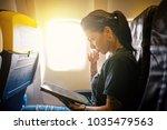 young woman portrait working... | Shutterstock . vector #1035479563