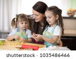 mom with her 2 and 5 years old... | Shutterstock . vector #1035486466