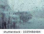 rain drops water on car window... | Shutterstock . vector #1035486484