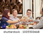 happy people drinking champagne ... | Shutterstock . vector #1035503668