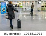 woman with a suitcase at the... | Shutterstock . vector #1035511033