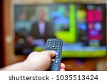 the man switches the news...   Shutterstock . vector #1035513424