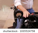 Small photo of Motorcycle straddle with hand right