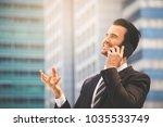 happy businessman in suit and... | Shutterstock . vector #1035533749