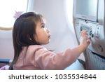 a little girl traveling by an... | Shutterstock . vector #1035534844