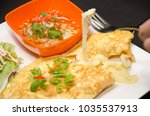 omelette cheese stretched out... | Shutterstock . vector #1035537913