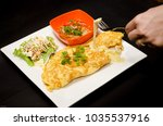 omelette cheese stretched out... | Shutterstock . vector #1035537916