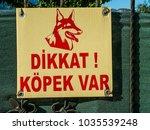 Small photo of Beldibi, Turkey - October 20, 2017: Sign on the gate: Attention, dog! (Dikkat! Kopek Var). turkish language