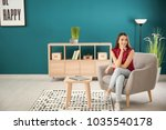 beautiful young woman sitting... | Shutterstock . vector #1035540178
