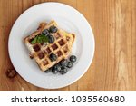 waffles with blueberries   mint | Shutterstock . vector #1035560680