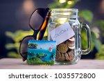 saving money in a jar for a... | Shutterstock . vector #1035572800