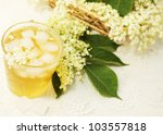 A cold refreshing summer drink made from elder flowers - stock photo
