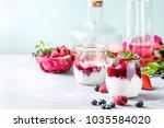 jars of natural white yogurt... | Shutterstock . vector #1035584020