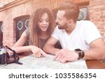 couple in an outdoor cafe using ... | Shutterstock . vector #1035586354