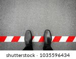 black shoes standing on the red ... | Shutterstock . vector #1035596434