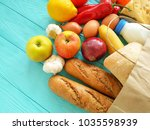 paper bag with different useful ... | Shutterstock . vector #1035598939