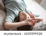 portrait of young girl lying on ... | Shutterstock . vector #1035599530