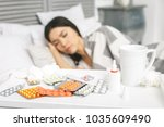 sick woman lying in bed with... | Shutterstock . vector #1035609490