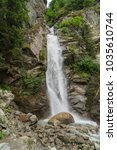 Small photo of Spectacular view of Cascade du Dard - a fantastic waterfall, located at 1233 m, a twenty meters high under Mont-Blanc, Haute-Savoie, France