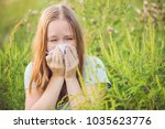 young woman sneezes because of... | Shutterstock . vector #1035623776