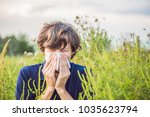 Young Man Sneezes Because Of A...