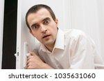 man opens or closes the door ... | Shutterstock . vector #1035631060