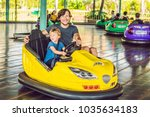 father and son having a ride in ... | Shutterstock . vector #1035634183