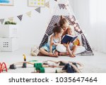 family mother reading to... | Shutterstock . vector #1035647464