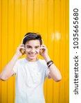 portrait of teen smiling with... | Shutterstock . vector #1035665680