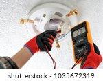 electrician technician measures ... | Shutterstock . vector #1035672319