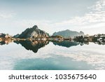 mirror reflection at sea... | Shutterstock . vector #1035675640