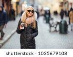 pretty girl wear sunglasses and ... | Shutterstock . vector #1035679108