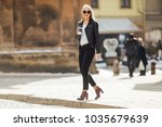 young pretty girl walk on the... | Shutterstock . vector #1035679639