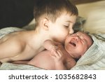 two brothers are lying on a...   Shutterstock . vector #1035682843