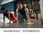 shot of young couple exercising ... | Shutterstock . vector #1035683014