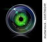 eye inside a camera photo lens  ... | Shutterstock .eps vector #1035700249