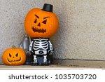 jack o lantern skeleton on... | Shutterstock . vector #1035703720