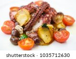 grilled octopus with cherry... | Shutterstock . vector #1035712630