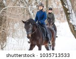 two sportswomen riding hers bay ...   Shutterstock . vector #1035713533