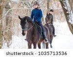 two sportswomen riding hers bay ... | Shutterstock . vector #1035713536