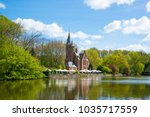 minnewater castle at the lake... | Shutterstock . vector #1035717559