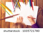the child's hands are painted... | Shutterstock . vector #1035721780