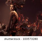 sexy attractive nude woman in burning ashes - stock photo