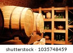 old wine cellar with wooden... | Shutterstock . vector #1035748459
