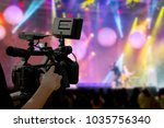 the filmmaker is recording and... | Shutterstock . vector #1035756340