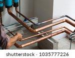 hvac technician soldering a...   Shutterstock . vector #1035777226