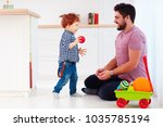 happy father playing with cute... | Shutterstock . vector #1035785194