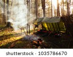 bushcraft campsite with smoke... | Shutterstock . vector #1035786670